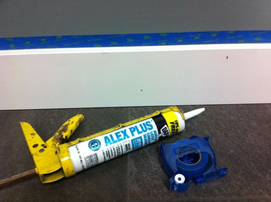 I used this Alex Plus caulk. It's cheap. It's paintable. It works. And I also bought this little 3M tape thing. It runs along the edge of whatever you're taping for a zero-tolerance line.It worked. It's 3M. 3M is not sponsoring this post BTW. But you guys can call me and send me just about anything you want and I'll use it.
