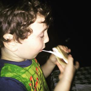 The kid devouring a homemade smore The only thing hehellip