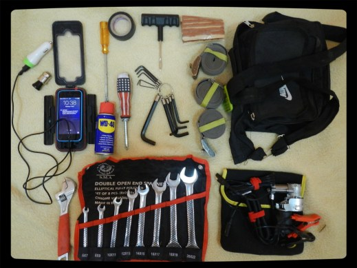 My basic tool kit spanner set, screwdrivers,  WD40, alan keys, shifter, electrical/gaffa tape, tubeless repair kit, small electric pump, iPhone and GPS wired in with a ciggie lighter unit.