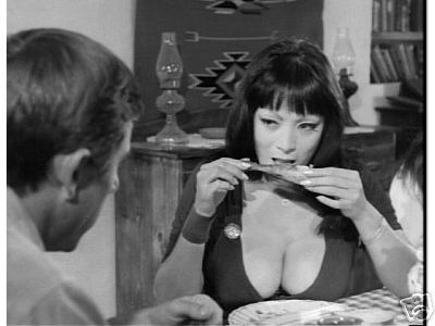 Tura Satana eats suggestively