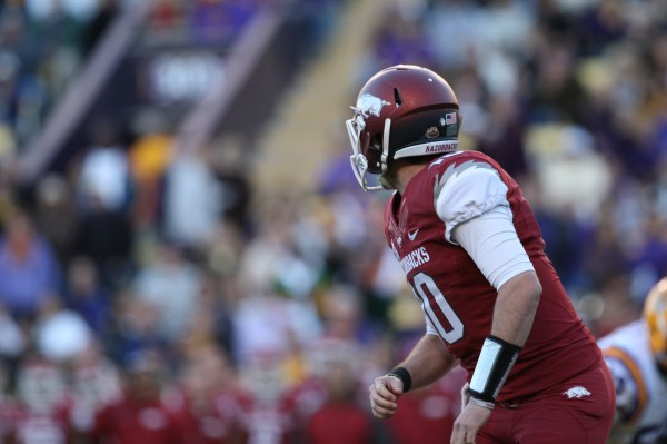 Arkansas QB Brandon Allen looks downfield as the throws a pass.