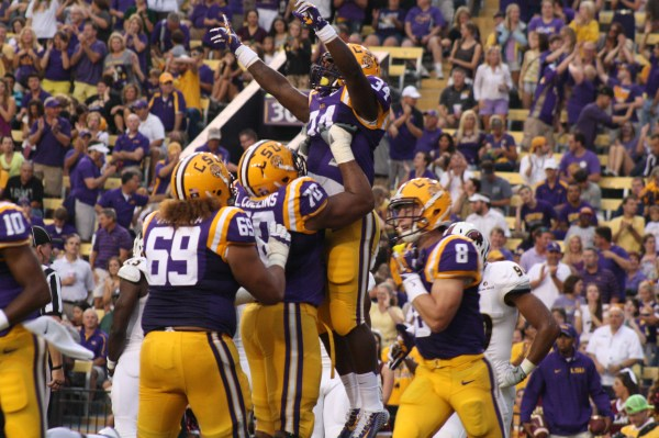 LSU rb Darrel Williams gets lifted up no. 70 Collins for the score.