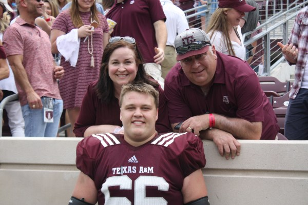 Texas A&M guard Robert Congel at the A&M Spring Game with his mom and dad