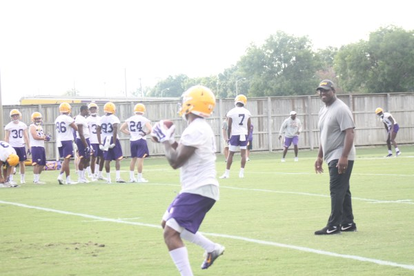 LSU backup RB Nick Brossette catches a pass and turns up field.