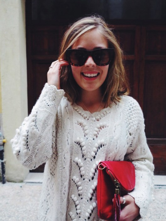 Cream knit and red leather clutch