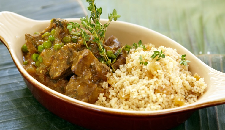 Lamb tagine served with warm Moroccan couscous salad
