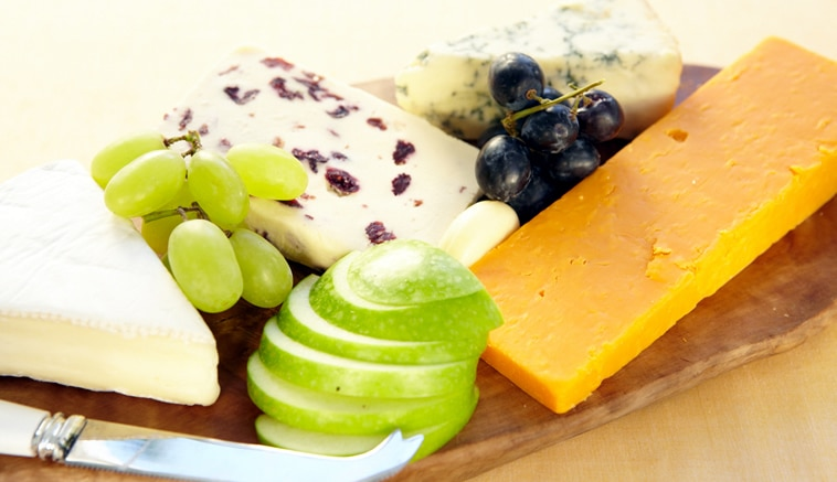 Cheese board with green & red grapes