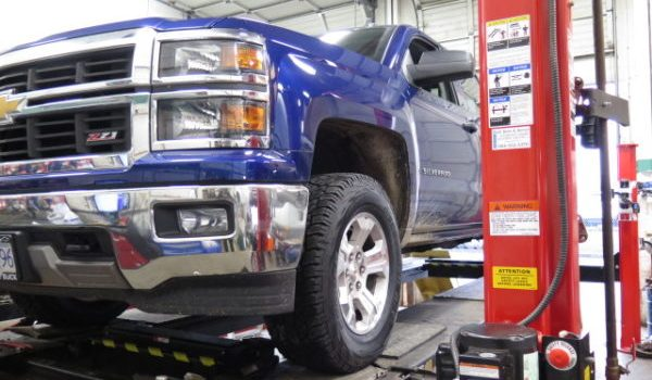 '14 Silverado TRUXXX level off kit and new tires at Dales Auto Service