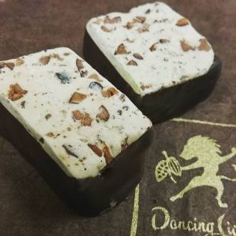 WHO KNEW? - soft nougat with Madagascar cacao and Imperial Sichuan peppercorns in deep Honduran 80% dark chocolate