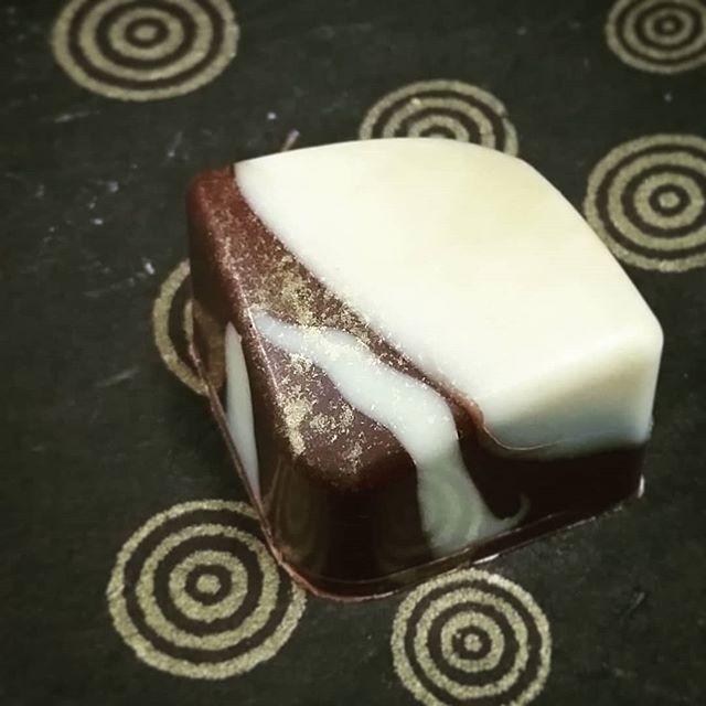 GOLDEN BUDDHA? - Buddha's Hand & Yuzu cloud caramel in White Jade & Mesoamerican dark.#Chocolatier #chocolate #visitmanchesternh #boxofchocolates #gift #buddhashand #yuzu #cloudcaramel #caramel #dantachocolate #mesocacao