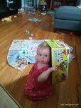 Abigail playing with her Duplo box.