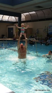 Uncle Dom showing Abby how to fly.