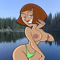Curvy milf Madeline Fenton posing in her tiny green bikini only!