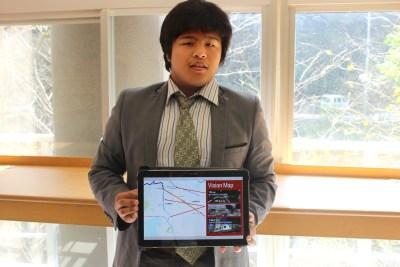 Blog owner Daryl Dela Cruz holding up the Better Surrey Rapid Transit vision for skytrainforsurrey.org