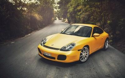 Yellow Porsche 996 on the road HD desktop wallpaper : Widescreen : High Definition : Fullscreen