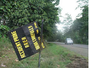 This road sign in Maluko, Bukidnon, warns of accidents. (davaotoday.com photo by Carlos H. Conde)