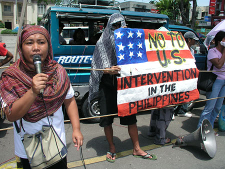 Evelyn Carias of the Moro women group Khadidja denounces the US during a rally May 8. (davaotoday.com photo by Barry Ohaylan)
