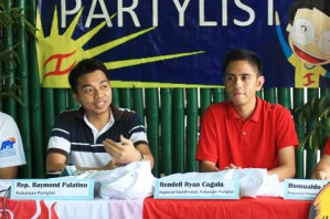 MAKE A MOVE.  Kabataan Partylist's Raymond Palatino (left) and Rendell Ryan Cagula urge President Aquino, the Ched, DepEd and Congress to stop increases in school fees.  (davaotoday.com photo by Medel V. Hernani)