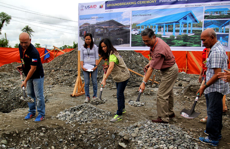 BAGSAKAN PROJECT.  Gloria Steele (in brown vest) of the United States Agency for International Development (USAID) leads the ground breaking ceremony of the new trading center in Poblacion village, Compostela town, Compostela Valley on Friday.  The project, designed to withstand extreme weather conditions, is worth PHP 2.5 Million and part of USAID's disaster recovery assistance to the communities affected by typhoon Pablo.    (davaotoday.com photo by Ace R. Morandante)
