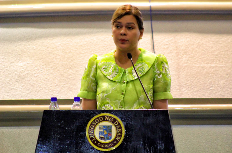 ACCOMPLISHMENT REPORT.  Davao City Mayor Sarah Duterte-Carpio narrates Tuesday what the city has achieved under her governance in the last three years.  This is her third, albeit last, state of the city address as mayor.  On July, her father Rodrigo Duterte will assume her post after winning the recent election.  (davaotoday.com photo by Ace R. Morandante)