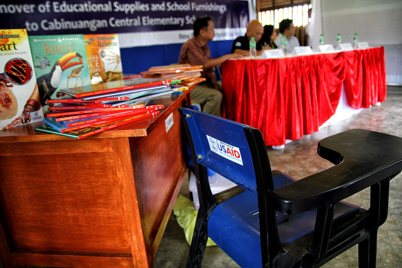 RECOVERY ASSISTANCE.  The United States Agency for International Development turns over school furniture and education supplies worth PHP 1.2 Million to the Cabinuangan Central Elementary School in Cabinuangan village, New Bataan town, Compostela Valley on Friday.  The Pablo-affected school received 1,586 student kits, 53 teacher kits, 53 blackboards, 540 student desks, 12 teacher tables and chairs, reference materials and 53 sets of books.  (davaotoday.com photo by Ace R. Morandante)