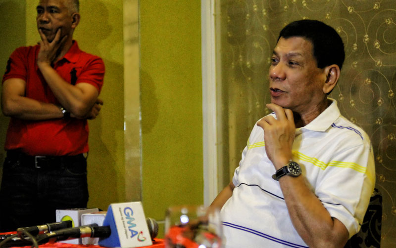OUT OF OFFICE.  Davao City Mayor Rodrigo Duterte says he won't be in office for a week or two as his administration works to fill the department head posts who will be joining his staff.  Duterte officially assumed office on Monday after taking his oath last Sunday.  (davaotoday.com photo by Ace R. Morandante)