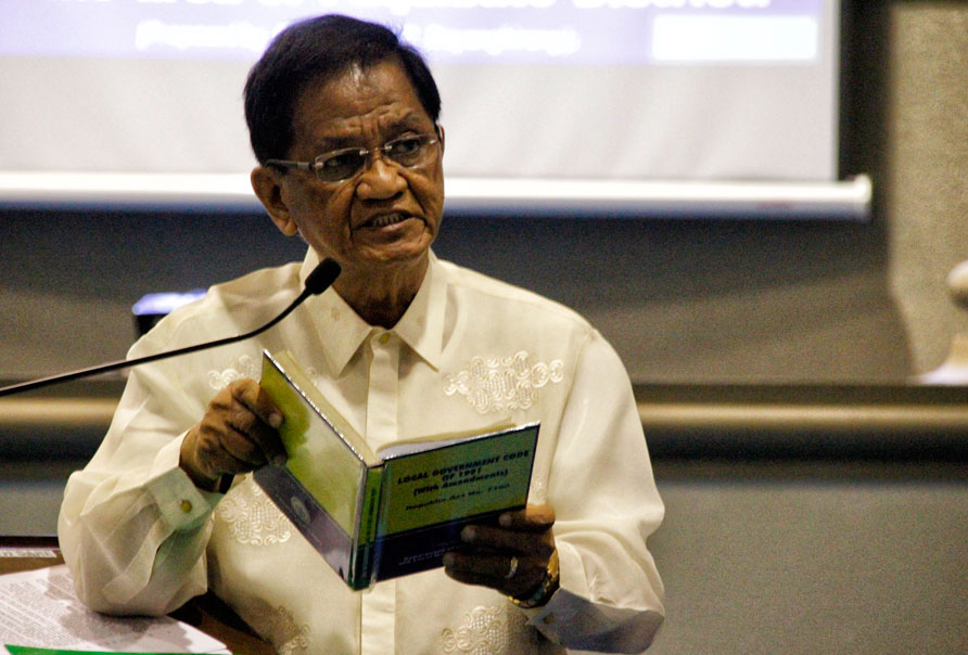 LECTURE First District Councilor Atty. Melchor Quitain reads the Local Government Code during Tuesday's City Council session to remind fellow councilors on the local government's capacity to stop mining in the city. (davaotoday.com photo by MEDEL V. HERNANI)