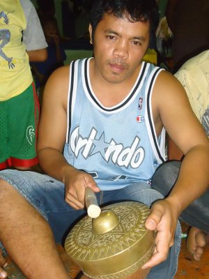 KASAKA leader Benjie Planos playing an ethnic gong last August during the evacuation of the Manobos in Bankerohan Gym (contributed photo)