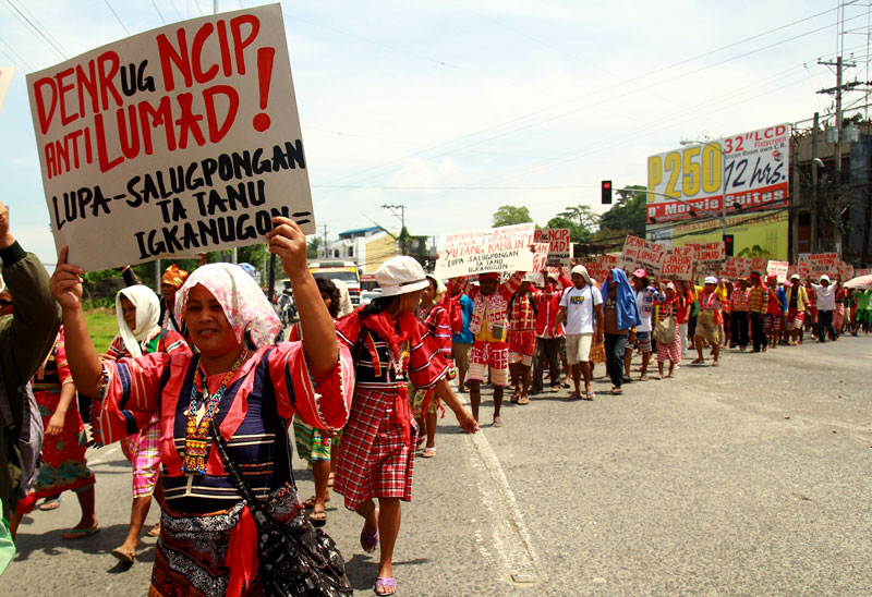LUMADS PICKET LOGGING FIRM Hundreds of Ata-Manobos from Talaingod, Davao del Norte marched at the office of logging firm Alcantara & Sons in Lanang, Davao City Wednesday to protest the company's Integrated Forest Management Agreement, which they said is a commercial logging venture encroaching their ancestral domain. (davaotoday.com photo by Ace R. Morandante)