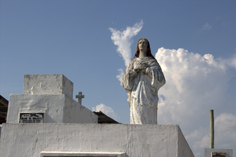 DOVE CLOUD A dove-shaped cloud rises above a statue of Blessed Virgin Mary in a tomb in Wireless Cemetery. Hundred thousand Davaoeños are expected to flock cemeteries on All Saint's Day on Friday. (davaotoday.com photo by Medel V. Hernani)
