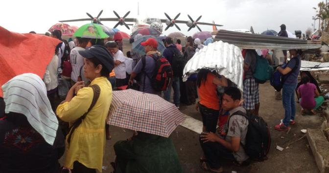 Waiting for their ride out at Tacloban City Airport. (photo courtesy of John Javellana)