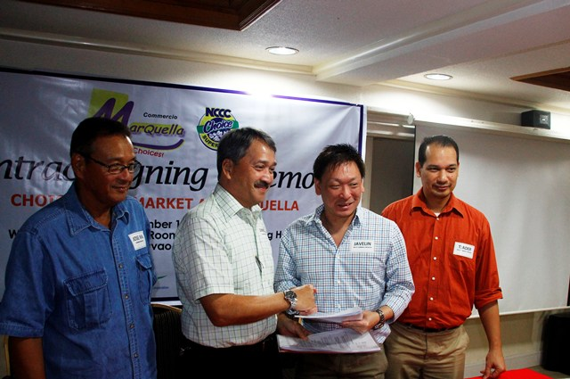 HAND SHAKE A lease agreement to build NCCC Choice Supermarket at Commercio Marquella at Tigatto-Mandug area was signed Friday between LTS Supermarket President Javelin Lim (2nd right) and Northbank Holdings Corp President Simeon Marfori II.  The supermarket will rise next year to provide goods and services to some 30,000 residents in the area. (davaotoday.com photo by Medel V. Hernani)