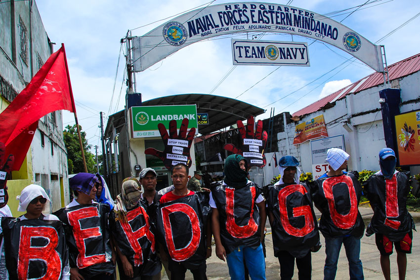 Union workers from Compostela Valley Province rallied outside the entrance of the Armed Forces' Eastern Mindanao Command criticizing alleged military harassment on their leaders.