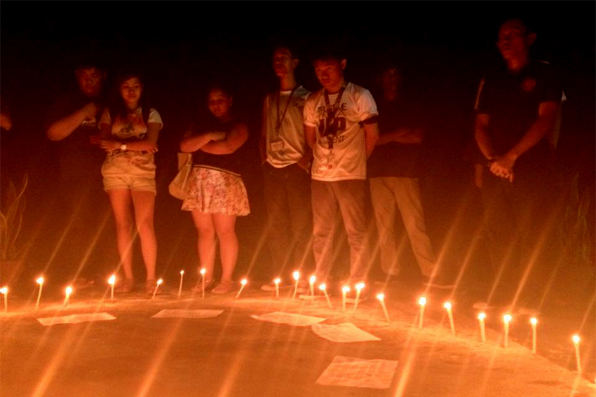 Students light up candles for UP campuses affected by Yolanda