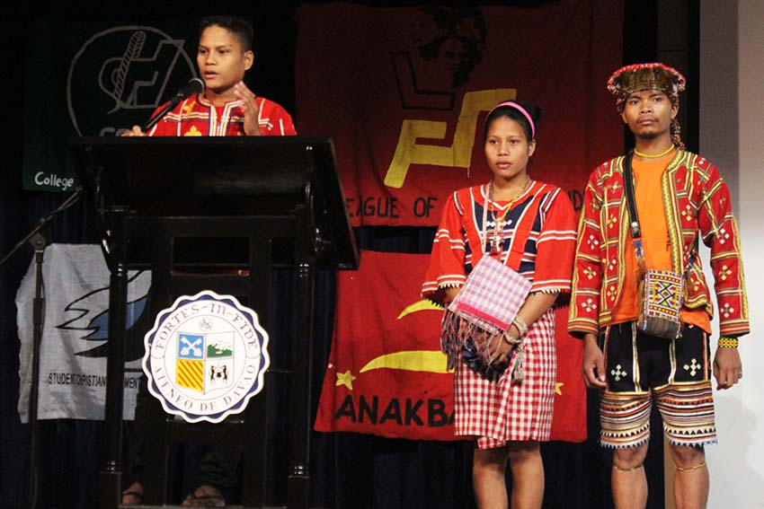 Ata Manobo cousins (left to right) Alvin and Jinky Malibato, who stopped schooling after their community school was not granted a permit to operate due to allegations that it is supported by the New People's Army, join the State of the Youth Address initiated by various youth groups in Davao City on Saturday. (medel hernani)
