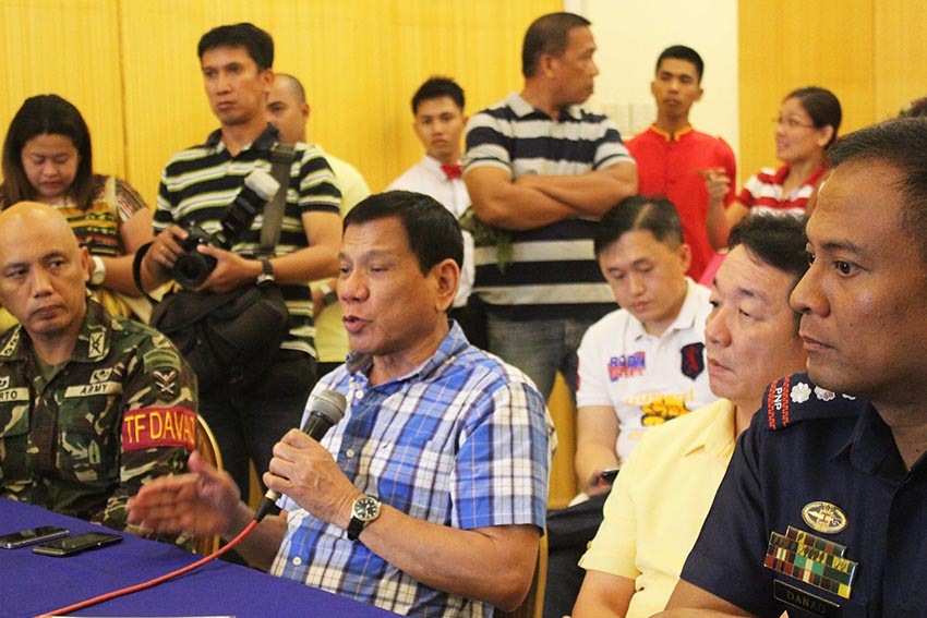 Davao City Mayor Rodrigo Duterte discusses during command conference held Wednesday at Menseng Hotel the security plan for the Kadayawan Festival with  Davao City Police Office Chief Sr. Supt. Vicente Danao Jr. (right) and TF Davao Chief Col. Macairog Alberto (left).