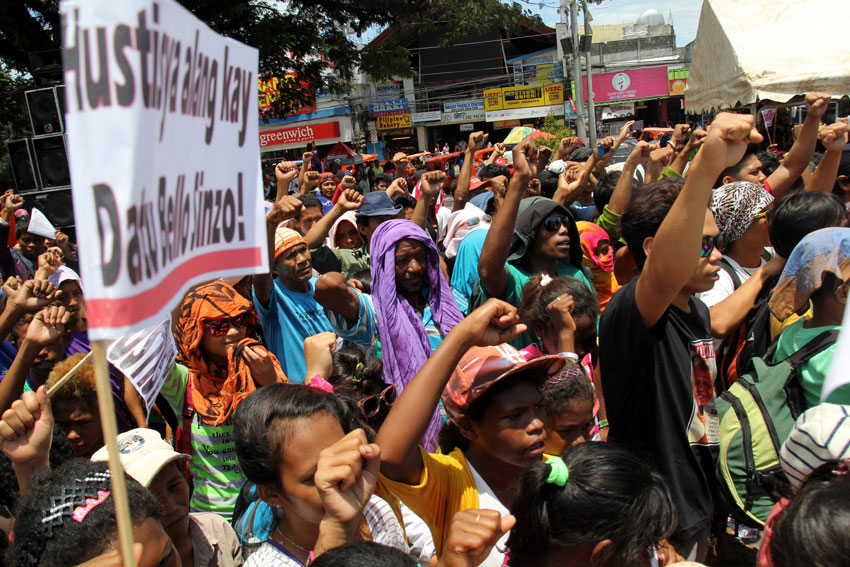 People raise their fists for Emerito Samarca as the sign to continue the struggle what was left by there Sir Emok.