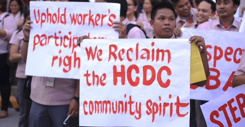 Holy Cross of Davao employees protest new guidelines in grievance procedure