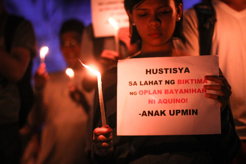 LIGHTS FOR LUMADS.  Students from the University of the Philippines Mindanao campus light candles on Friday to condemn the continuing harassment and killing of Lumads in Mindanao. (Paulo C. Rizal/davaotoday.com)