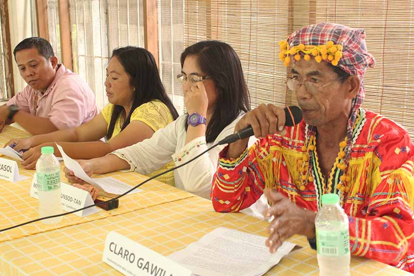 Claro Gawilan is joined by (from left to right) Reverend Sarly Templado of the United Church of Christ in the Philippines, Rev. Joy Mirasol, and Milagros Maglunsod-Tan of the Mindanao Integrated Services Foundation Inc. Academy during their presentation of the report from the three-day mission conducted in Kitao-tao, Bukidnon last week. The group said 55 families have already evacuated in Arakan Parish, leaving their farms unattended due to fear of being tagged as rebels or rebel supporters. (Medel V. Hernani/davaotoday.com)