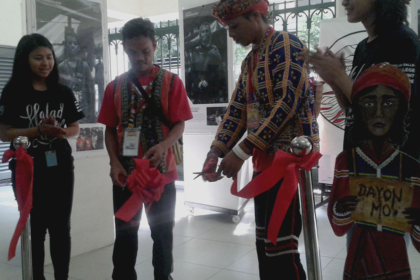The De La Salle - College of St. Benilde starts its week-long photo exhibit dubbed as 'Halad sa Lumad' (Offer to Lumads) to depict the plight of Lumads in Mindanao. Datu Bogok, together with De La Salle students led the ribbon cutting. (contributed photo)