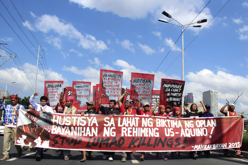 Lumads from Mindanao, together with support groups, march out of their camp in Liwasan Bonifacio to the Department of Justice in Manila calling for justice to the victims of the government's counter-insurgency program, Oplan Bayanihan. (Earl O. Condeza/davaotoday.com)