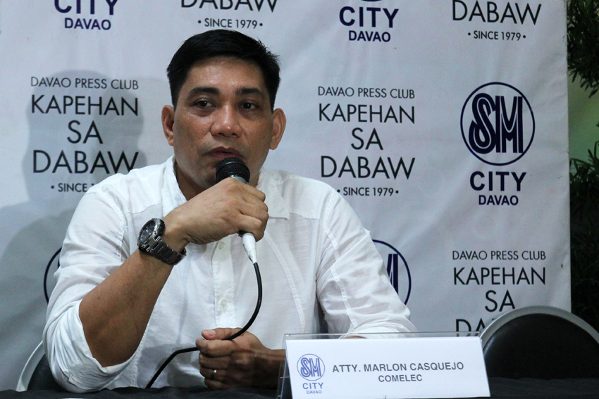 POSTER 'STRIPPERS'. Atty. Marlon Casquejo, assistant director of Comelec Region XI, says that their office and the Department of Public Works and Highways are now starting to tear down all election and non-election materials posted on prohibited areas. (Ace R. Morandante/davaotoday.com)