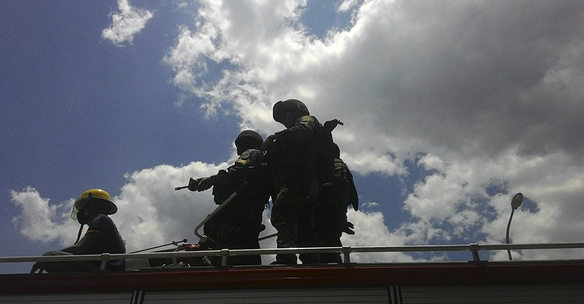 Members of the SWAT team are positioned atop fire trucks. (Contributed photo by Kathyrine Cortez)