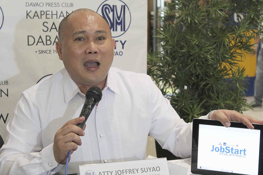 """Atty. Joffrey Suyao of the Department of Labor and Employment (DOLE) introduces """"Job Start"""" program which offers skills training to applicants with P200 pesos allowance per day. Suyao said they accommodate 2,000 to 3,000 job seekers a day. (Medel V. Hernani/davaotoday.com)"""