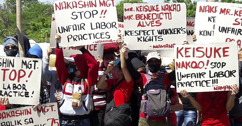 Dismissed workers set up camp to demand reinstatement