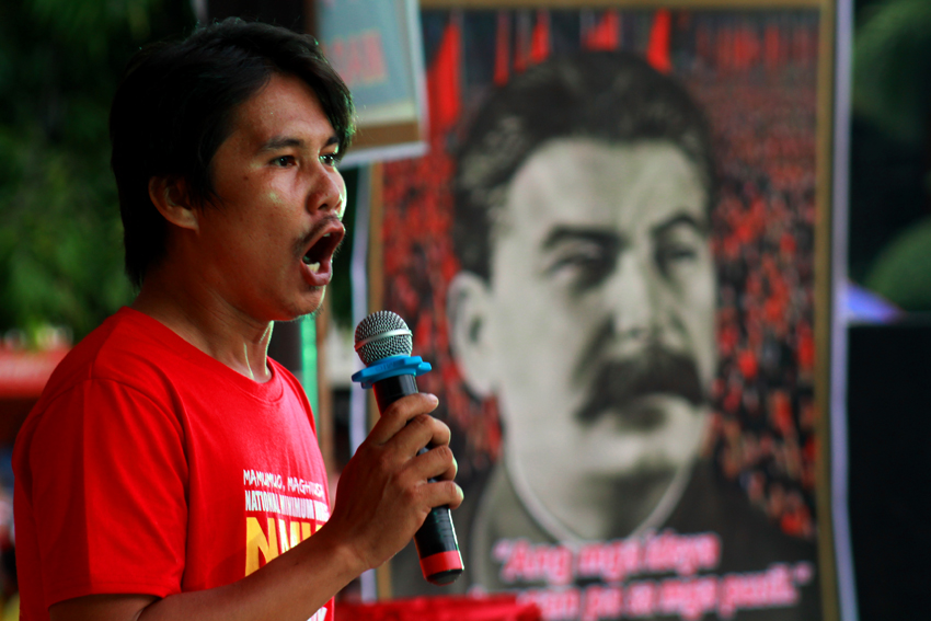 Carlo Olalo, spokesperson of Kilusang Mayo Uno challenges all the presidentiables to end contractualization in the country. On the background is a photo of the Russian leader, Joseph Stalin.