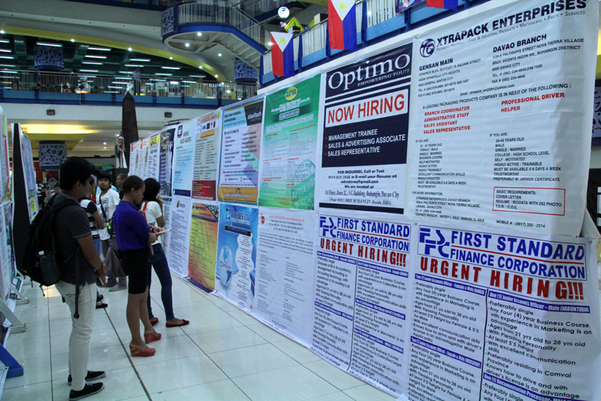 Huge tarpaulins are displayed at the NCCC Mall in Davao City showing various companies that offer slots for applicants among fresh graduates and unemployed youth.(Ace R. Morandante/davaotoday.com)