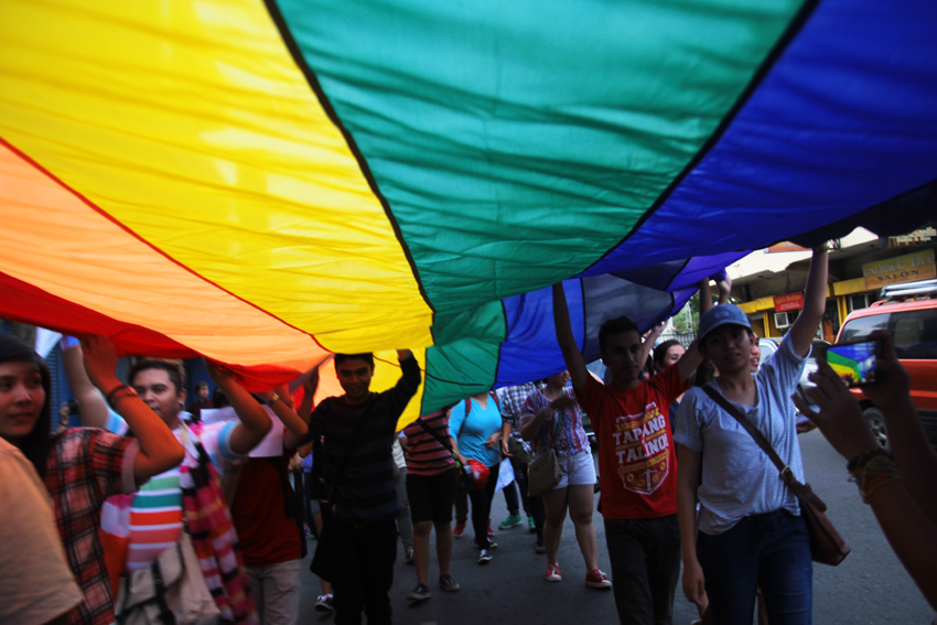 Members of the LGBT community carry a giant rainbow flag as they march against discrimination during the first Pride March in Davao City on Wednesday, June 1. (Ace R. Morandante/davaotoday.com file photo)