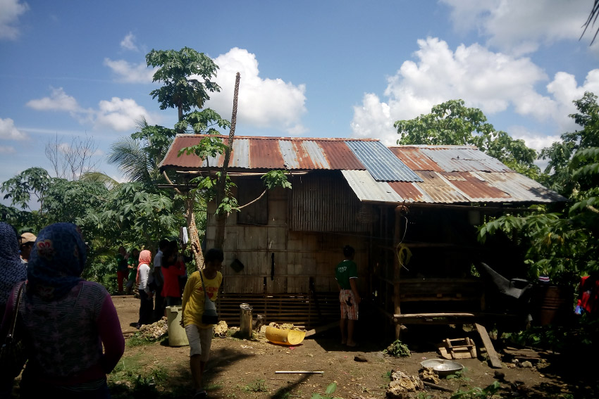 The house where two members of the family decide to take their rest before working as rubber tappers, least expecting a strafing incident to happen soon. (Earl O. Condeza/davaotoday.com)
